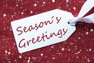 One Label On Red Background, Snowflakes, Text Seasons Greetings Stock Photos