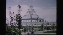 1957: male and female tourists are strolling down a picturesque walkway  Stock Footage