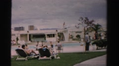 1957: people sitting by the pool at an rv park other people walking and enjoying Stock Footage