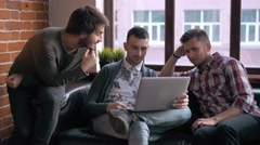 Group of entrepreneurs working and taking notes together in a little office Stock Footage