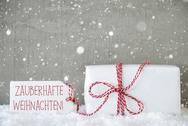 Gift, Cement Background With Snowflakes, Weihnachten Means Magic Christmas Stock Photos