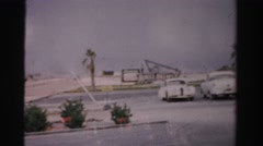 1957: cars in a parking lot next to a sign and a large tower LAS VEGAS, NEVADA Stock Footage