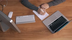 Top view of a man working on his laptop in beautiful office interior Stock Footage