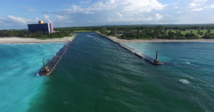 Bird's-eye panoramic view around the shore of Caribbean Sea, piers conducting a Stock Footage