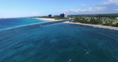 Bird's-eye panoramic view to the shore of Caribbean Sea, piers conducting a Stock Footage