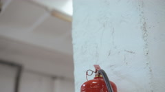 Close-up fire extinguisher at the factory on the white background 4K Stock Footage