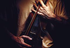 Holding an Old Violin Stock Photos