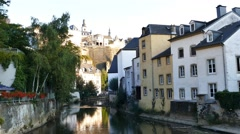 Beautiful Alzette river side scene on road Rue Munster Stock Footage