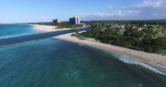 Bird's-eye panoramic view from the shore of Caribbean Sea to piers conducting a Stock Footage