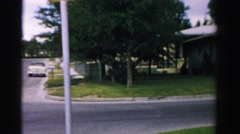 1957: a view of a neighborhood street and someone sitting out of house Stock Footage