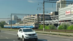 Electric passenger train passes alongside Mykoly Hrinchenka Street in Kiev Stock Footage
