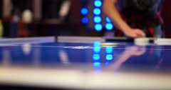 Air Hockey Game in Arcade / Amusements - Close Up Stock Footage