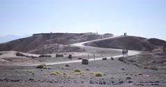 Death Valley: Tourists Walking to Zabriskie Point Stock Footage