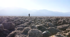 """Tourist Walking at """"Devil's Golf Course"""", Death Valley National Park, California Stock Footage"""