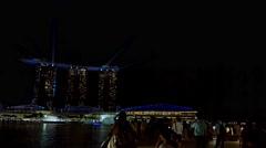 Tourists enjoying dramatic evening light show of Sands at Marina Bay. Singapo Stock Footage