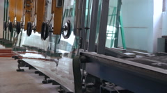 Machine is Laying Down Large Sheets of Glass. Full HD Stock Footage