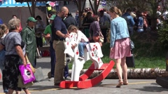 Kids riding on rocking horse toys on Manezh Square in Moscow, Russia Stock Footage