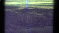 1967: going on a trip to a new place where there are hills and mountains  Stock Footage