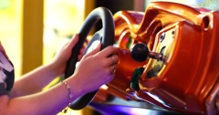 Playing Driving Arcade Video Game - Player Using Steering Wheel Controller. Stock Footage