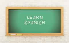 3D Chalkboard with learn Spanish. Stock Illustration