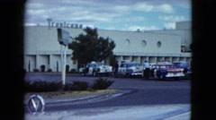 1959: landmark office cars parked man standing tall trees lamp post roads Stock Footage