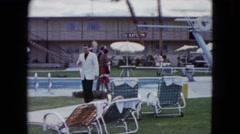 1959: suited man walking swimming area hotel staff ARIZONA Stock Footage