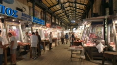 Wide view of butcher's stalls at athens central market Stock Footage