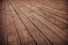 Grunge photographic background - diagonal old wooden floor boards Stock Photos