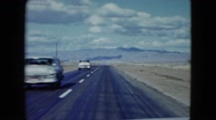 1959: vehicles are moving fast along the highway in a vast land ARIZONA Stock Footage