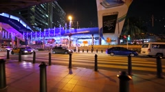 Crossing the road at crosswalk in KL downtown. Night. Buildings are illuminated Stock Footage