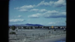 1959: view from a moving vehicle of wide plains with mountains and trees in the Stock Footage