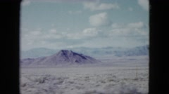 1959: view from a moving car of desert, mountains, the unending open road ahead Stock Footage