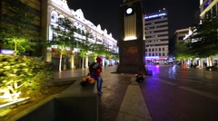 Promenade area with fountain in KL downtown at night. Tourists walk, take photos Stock Footage