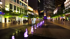 View of colourful fountain at night on the promenade area in KL downtown. Stock Footage