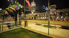 Tourists take photos of Sultan Abdul Samad Building at Merdeka Square in KL Stock Footage