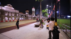 Walking along Sultan Abdul Samad Building at Merdeka Square in Kuala Lumpur Stock Footage