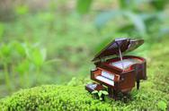 Miniature piano in nature Stock Photos
