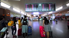 Interior of KL airport with passengers, departure board, check-in desk Stock Footage