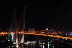 Night view of the bridge in the Russian Vladivostok over the Gol Stock Photos
