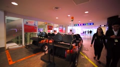 Tourist girl sits in cart of buggy service for passengers in KL airport Stock Footage