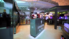 Louis XIII de Remy Martin store in duty free zone in KL International airport Stock Footage