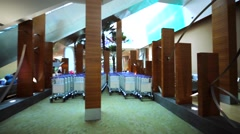 View of many empty luggage trolleys in Kuala Lumpur International airport. Stock Footage
