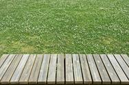 Wooden bench on lawn Stock Photos