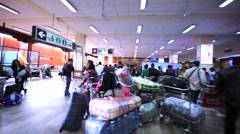 Interior of Kathmandu International airport with a lot of tourists and luggage. Stock Footage