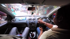 A taxi driver with a tourist takes the city tour of Kathmandu, Nepal Stock Footage
