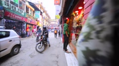 Walking along street with selling stands with clothes, souvenirs, driving cars Stock Footage