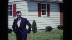 1959: man outdoor dog talking suit walking garden loving ARIZONA Stock Footage