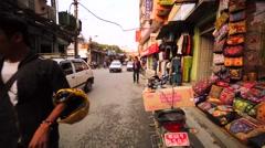 Walking along the street market with many things in Kathmandu, Nepal Stock Footage