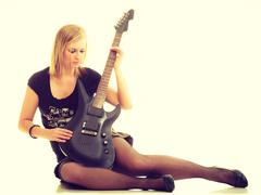 Woman artist player with electric guitar. Stock Photos