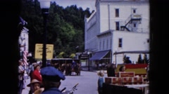 1961: various people gather outdoor on the street waiting for a parade MICHIGAN Stock Footage